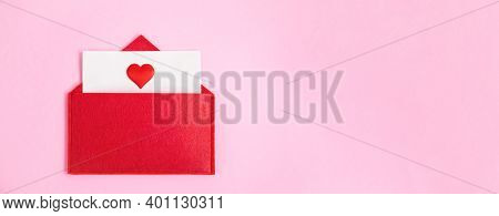 Banner Red Open Envelope With A Sheet Of Paper With A Heart On A Pink Background With Copyspace. Val