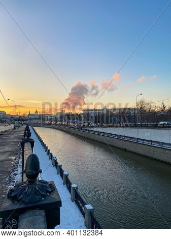 Moscow River Embarkment At Dusk. Blue Sky. Steam