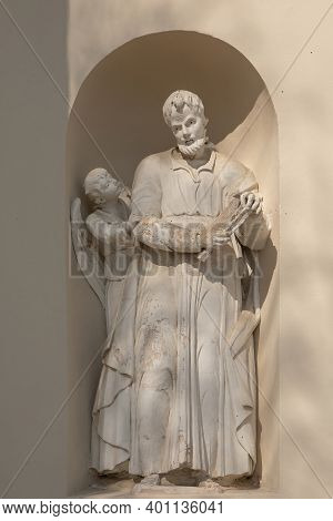 Suderve, Lithuania - April 2, 2017: Statue Matthew The Apostle On The External Wall Of The Church Of