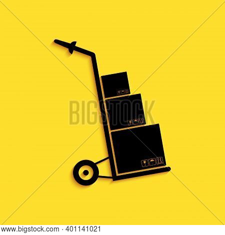 Black Hand Truck And Boxes Icon Isolated On Yellow Background. Dolly Symbol. Long Shadow Style. Vect