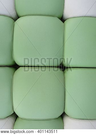 Green And White Leather Upholstery Of A Sofa. Fluffy Fabric Background. Green And White Leather Text