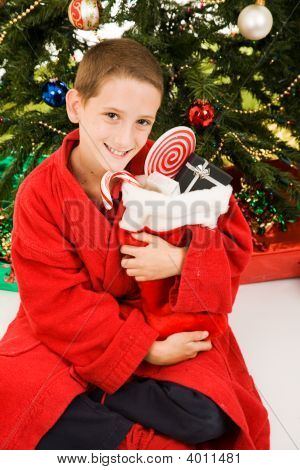 Little Boy And Christmas Stocking