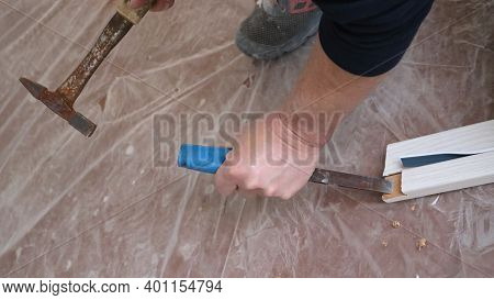 Working With A Hammer And Chisel In The Hands Of A Carpenter Top View, Hollowing Out A Niche In The