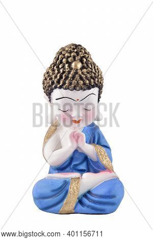 Ceramic Figurine Of Young Buddha Isolated On White Background With Clipping Path