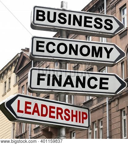 Business, Economics And Finance Concept. The Road Indicator On The Arrows Of Which Is Written - Busi