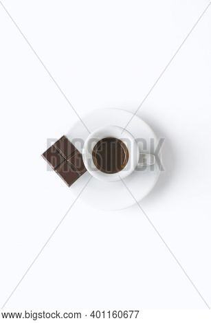 Milk coffee or latte macchiato glass, on white background. Italian coffee with milk and layers. Gour