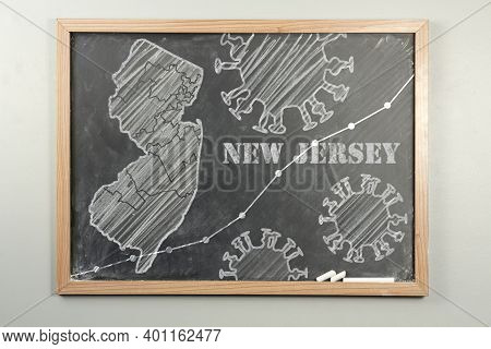 Chalkboard Drawing Of Nj With Coronavirus Pandemic And Line Graph Depicting The Spread Or Death Toll