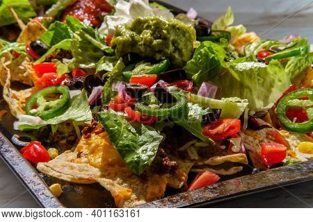 Loaded Toppings Beef Nachos With Guacamole Sour Cream And Tomato Salsa