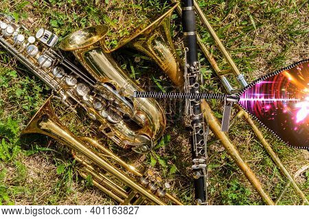 Musical Instruments Including Trombone Trumpet Clarinet And Saxophone Unzip To Reveal Neon Soundwave