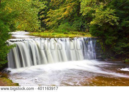 Kwisa Waterfall near town Swieradow Zdroj in Izera Mountains, Poland