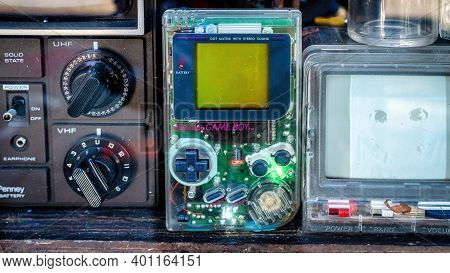 Nintendo Handheld Video Game Device Game Boy In A Shop Window Display With Transparent Cover
