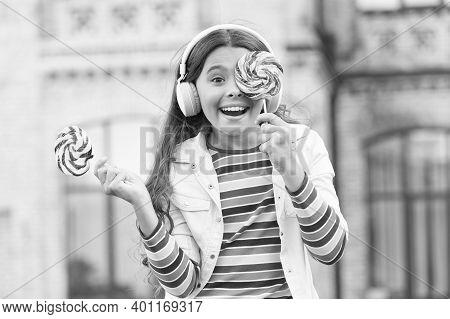 Cute Baby Girl. Kid Have Fun At Schoolyard. Healthy Food. Child Has Music Break. Girl In Headphones.