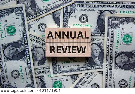 Annual Review Symbol. Concept Words 'annual Review' On Wooden Blocks On A Beautiful Background From