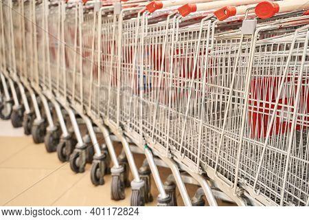 Retro Shop Trolley. Supermarket Shopper. Grocery Empty Detail. Red Basket At Mall. Market Interior.