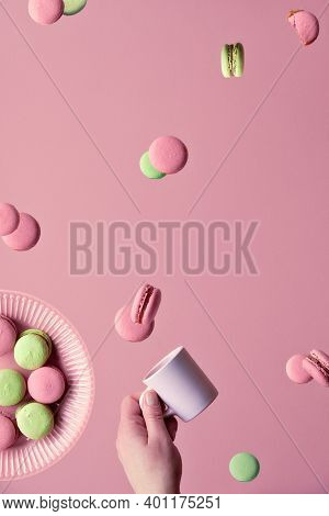 Levitation Of Macaroons, Creative Food Concept. Flying Macaroons, Plate And Hand With Coffee Cup. Pi