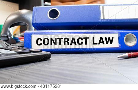 Blue Folder With The Label Contract Law