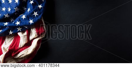 Martin Luther King Day Anniversary Concept. American Flag Against Black Wooden Background