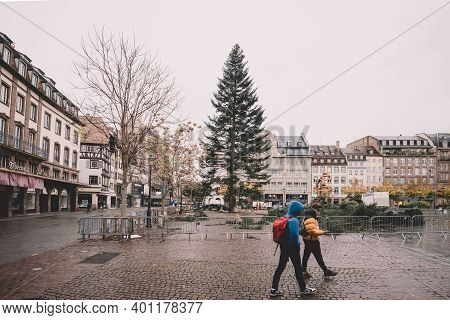 Strasbourg, France - Nov 3, 2020: Few Pedestrians In Front Of Decorated Yeti Christmas Tree In Centr