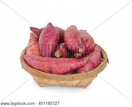 Fresh Sweet Potatoes Or Japanese Yam In Wooden Basket.