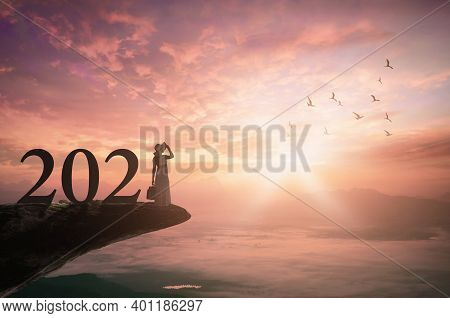 Success Businesswoman Of New Year 2021 Concept: Silhouette Traveler Woman With Text For 2021 Against