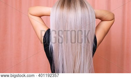 Beautiful Female Long Straight Blond Hair. Dyed Wavy White Blond Hair Background, Treatment Concept.
