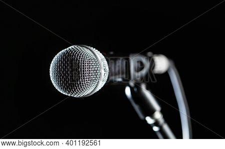 Closeup Microphone. Vocal Audio Mic On A Bleck Background. Live Music, Audio Equipment. Karaoke Conc