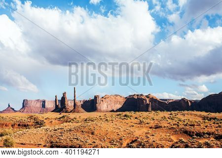 Monument Valley is a unique geological formation. Huge masses of red sandstone - outliers on the Navajo Indian Reservation. The USA. The concept of active and photo tourism