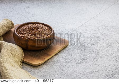 Flax Seeds In A Wooden Bowl On A Concrete Background, Dietary Cereal Ingredient, Cholesterol Lowerin