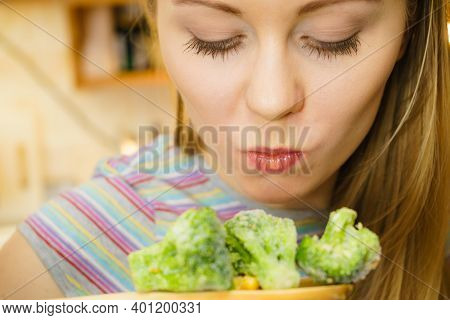 Woman In Kitchen Cooking Stir Fry Frozen Vegetables And Tasting. Girl Frying Making Delicious Risott