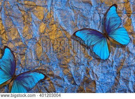 Blue Morpho Butterflies On Bright Shining Background. Gold Blue Texture Background. Golden Crumpled