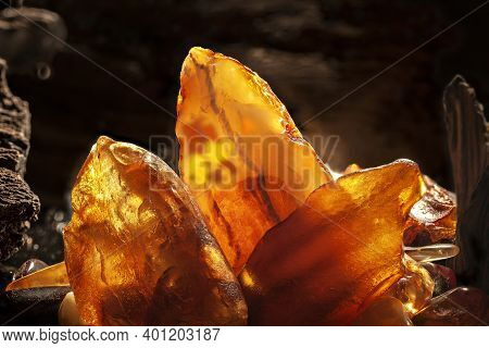 Beauty Of Natural Amber. Several Yellow Natural Amber Stones In A Cave.