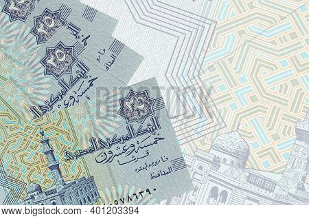25 Egyptian Piastres Bills Lies In Stack On Background Of Big Semi-transparent Banknote. Abstract Bu