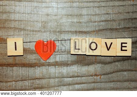 I Love You On A Wooden Background. Instead Of The Word Love Is A Red Heart. The Concept Of Love. Val
