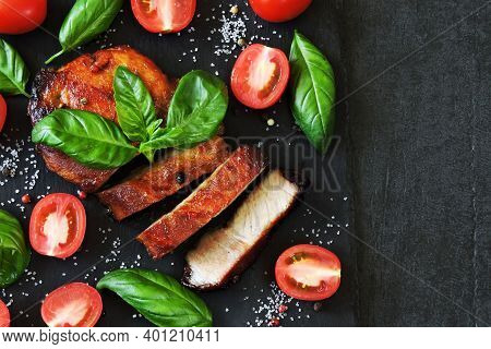 Appetizing Meat Steak On A Stone Board With Basil And Tomatoes. Keto Diet. Pegan Diet. Paleo Diet.