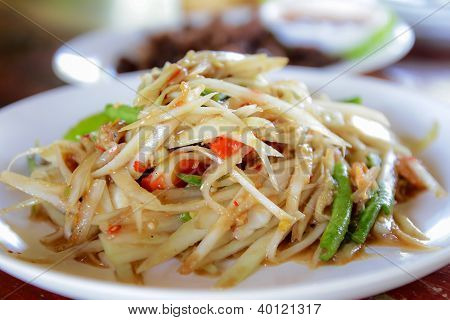 Thai papaya salad on white plateThai food poster