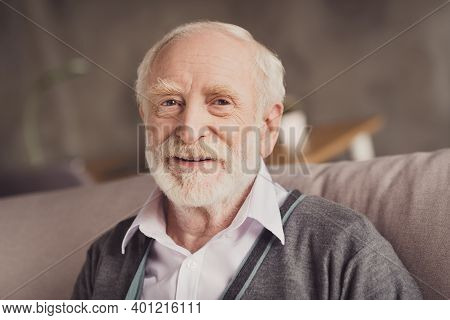Photo Of Positive Handsome Old Man Smiling Sitting Sofa Inside Indoors Flat Home House