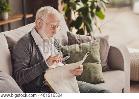 Photo Of Attentive Old Man Dressed White Shirt Spectacles Sitting Sofa Reading Loupe Last Articles I
