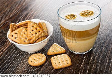 Different Cookies In White Bowl, Transparent Glass With Latte-macchiato On Dark Wooden Table