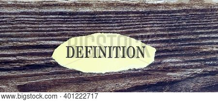 Business And Finance Concept. View Of Piece Of Paper Written Word Definition On Wooden Background,