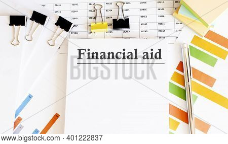 Paper With Words Financial Aid And Charts And Office Tools, Business