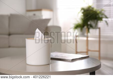 Box With Paper Tissues On Light Table In Living Room. Space For Text