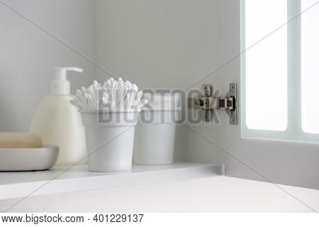 Cotton Buds And Different Toiletries On Shelf Indoors