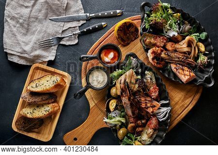 Grilled Seafood Platter. Assorted Delicious Grilled Seafood With Vegetables. Grilled Mixed Bastards