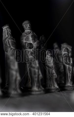 A Portrait Of The Black Stone Sculptured Army On A Stone Chessboard. They Are Setup For The Beginnin
