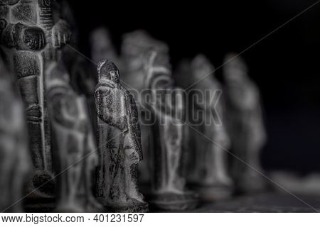 A Portrait Of One Of The Stone Pawns Sculptured As A Soldier In A Chess Game. The Strategic Duel Is
