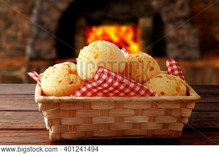 Homemade Cheese Bread, Traditional Brazilian Snack, In The Basket After Leaving The Oven On A Rustic