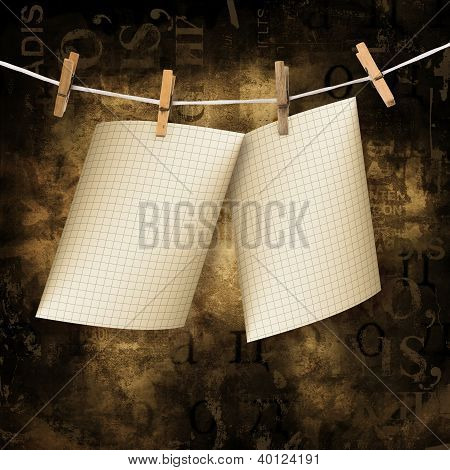 Old Sheets Hanging On A Rope And Clothespins On The Brown Abstract Background