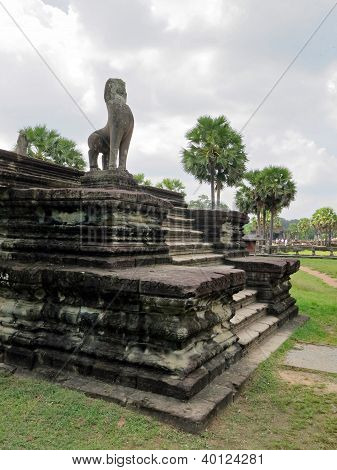 stairs to the temple with a statue of a lion