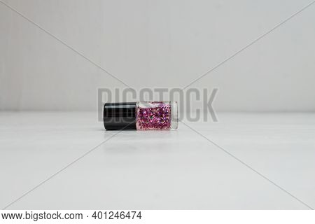 Glittery Colorful And Bright Nail Polish Isolated With Copy Space.