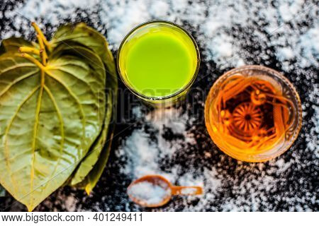 Face Mask For Controlling Oiliness Consisting Of Betel Leaves Juice, Honey, Sea-salt On A Black Wood
